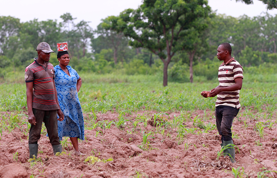 An extension officer advising farmers in Ghana