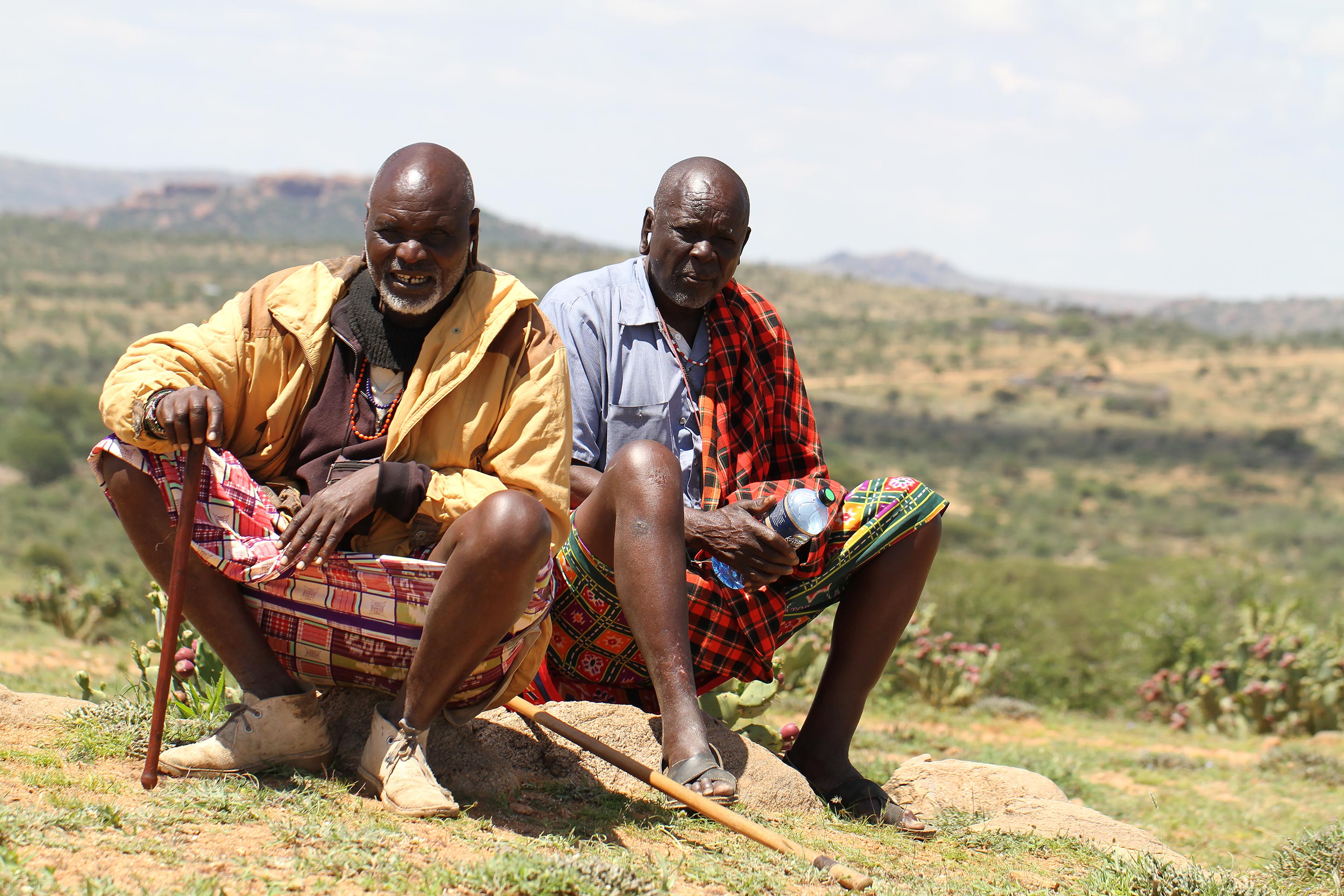 Two pastoralists sitting on a rock in northern Kenya